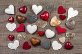 Collection of different red, white and brown hearts on wooden ba — Stock Photo