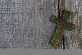 Wooden cross or crucifix on a background for a condolence card. — Stock Photo