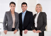 Portrait of three business people: man and woman in a team. — Stock Photo