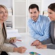 Professional business meeting: young couple as customers and an — Stock Photo #69311105