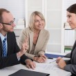 Career and candidate: three people sitting in a job interview fo — Foto Stock #69318311