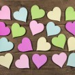 Collection on many colorful hearts on wooden background for love — Stock Photo #69692749