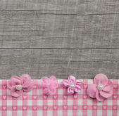 Four pink handmade flowers on wooden grey shabby chic background — Stock Photo