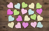 Collection on many colorful hearts on wooden background for love — Stock Photo