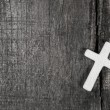 White cross on a grey wooden background. — Stock Photo #69720635