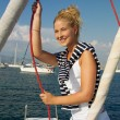 Attractive girl sailing on a yacht on summer day — Stock Photo #72411545