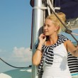 Attractive girl sailing on a yacht on summer day — Stock Photo #72411595