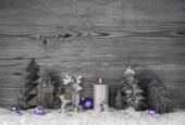 Grey wooden background with handmade reindeer, trees and violet — Stock Photo