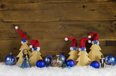 Wooden christmas background with red, white, brown and blue deco — Stock Photo