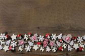 Rustic wooden christmas background with red and white checked de — Stock Photo