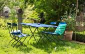 Nice relaxing place in the garden with blue furniture of wood. — Stock Photo