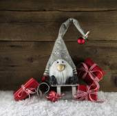 Imp santa with red christmas presents in rustic country style. — Stock Photo