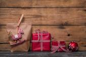 Classical red christmas gifts wrapped in paper with handmade sew — Stock Photo