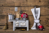 Vintage christmas decoration with cutlery, pots and other kitche — Stock Photo