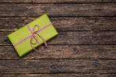 One green gift box wrapped in apple green box with red white che — Stock Photo