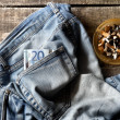 Pair of dirty jeans,twenty euro bill and an ashtray — Stock Photo #53412051