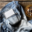 Pair of dirty jeans,notepad and an ashtray — Stock Photo #53412095