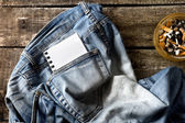 Pair of dirty jeans,notepad and an ashtray — Stock Photo