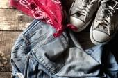 Dirty old jeans. sneakers and bandanna — Stock Photo