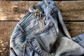 Dirty jeans on floor with tools in the pocket — Stock Photo