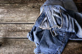 Dirty jeans on floor — Stock Photo