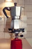 Preparing espresso on a camping gas — Stock Photo