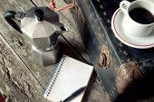 Espresso coffee, espresso maker and notepad — Stock fotografie