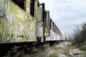 Old and abandoned passenger train — Stock Photo