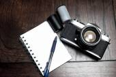 Notepad and photography equipment — Stock Photo