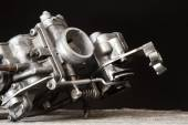 Carburetor on wooden surface — Stock Photo