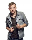 Portrait of a confident young man in jeans jacket on a white bac — Stock Photo
