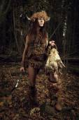 Ancient woman hunter in the forest with an ax in his hand. Histo — Stock Photo