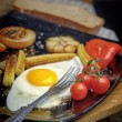 Fried egg on a plate with grilled vegetables. — Stock Photo #59156277