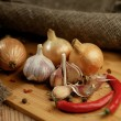 Onions, chili and garlic on a wooden table. — Stock Photo #59156587