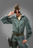 Sexy girl dressed as a helicopter pilot posing in sunglasses — Stock Photo