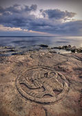 Sea-coast with ancient pictographs on the rocks — Stock Photo