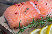 Raw Salmon Fish Fillet with Lemon and Fresh Herbs — Stock Photo