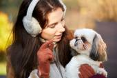 Young woman playing with a small dog — Stock Photo