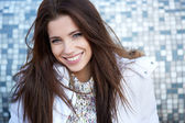 Beautiful young woman smiling in winter time — Stock Photo