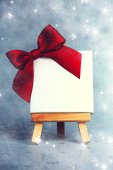 Wooden easel with blank canvas on christmas background  — Stockfoto