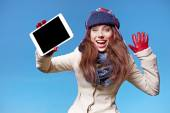 Christmas, x-mas, electronics, gadget concept - smiling woman in — Stock Photo