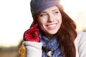 Beautiful young woman smiling on a winter's day — Stock Photo
