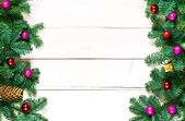 Christmas background with spruce tree and christmas balls on tab — ストック写真
