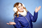 Winter woman in warm clothes and with ear muff  — Stock Photo
