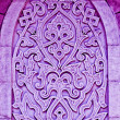 Ancient Islamic decorative ornamental carvings sculpture on colourful wall — Stock Photo #72741817