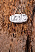 Love on wooden texture background, valentines day.  — Stock Photo