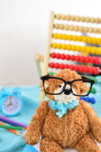 School supplies. Teddy bear with glasses — Stock Photo