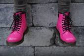 Hot Pink alternative girl or woman boots - sitting  tough — Stock Photo