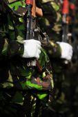 Soldier hand on AKM rifle — Stock Photo