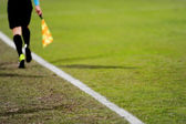 Assistant referee in action — Stock Photo